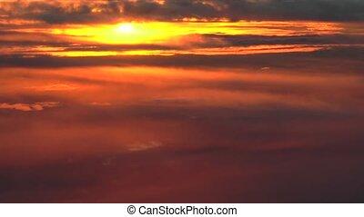 Colorful sunset clouds. Unique, actual high altitude footage.