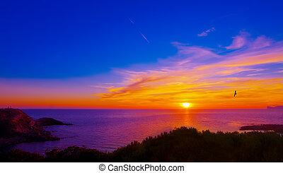 colorful sunset in Alghero coastline