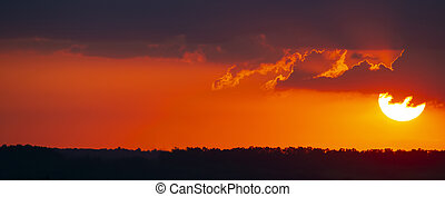 Colorful sunset in the evening sky. The nature and beauty of clouds