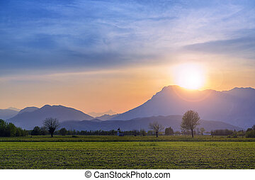 Colorful sunset in the mountain valley at Friuli, Italy with...