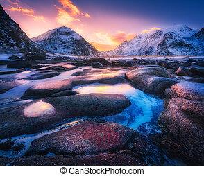 Colorful sunset in Utakleiv beach, Lofoten islands, Norway