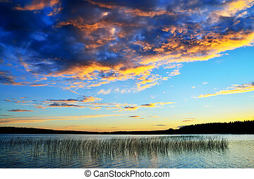 Colorful sunset. Lake Momsayarvi, Karelia, Russia