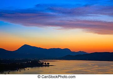 Colorful sunset over Aegean sea, Greece