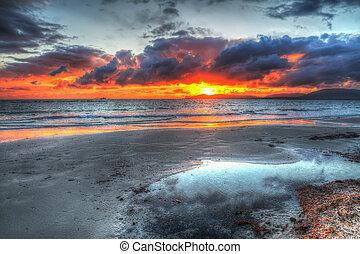 colorful sunset over Alghero coastline