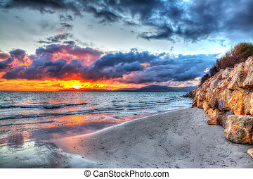 Colorful sunset over Alghero shoreline