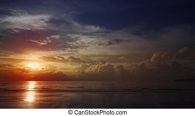 Colorful Sunset over Andaman Sea, off Phuket Thailand -...