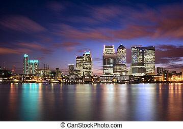 Colorful sunset over Canary Wharf, London skyline