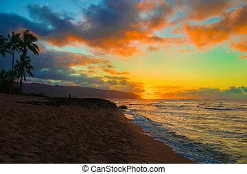 Colorful sunset over ocean at Haleiwa, Hawaii, Oahu island