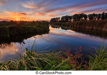 Colorful sunset over the beautiful little river