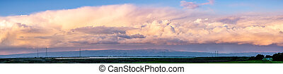 Colorful sunset over the marshes and mountains of south San Francisco bay area, California