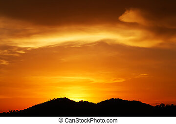 sunset over the mountain hills