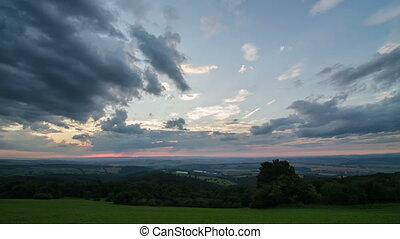 Colorful sunset sky over countryside time lapse panoramic