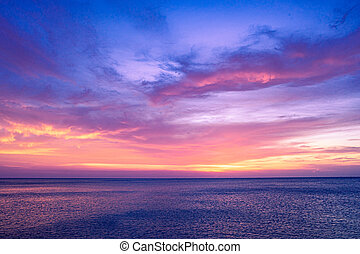 Colorful sunset sky over the ocean with dramatic cloud formation