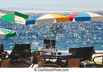 Colorful sunshades and beach chairs