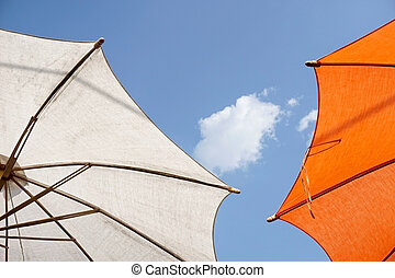 colorful sunshades umbrellas on a sunny summer day