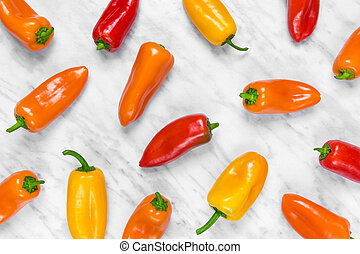 Colorful sweet peppers on marble background