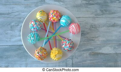 Colorful sweets on plate. Assortment of cake pops with beautiful decoration. How to make cake pops.