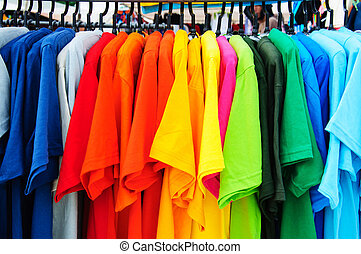 colorful t-shirt with hangers in market