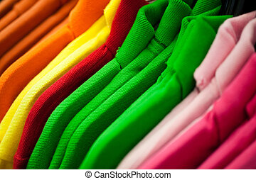 Colorful T-shirts - Colorful t-shirts hanging on a rack