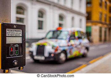 Colorful taxi at a pedestrian crossing