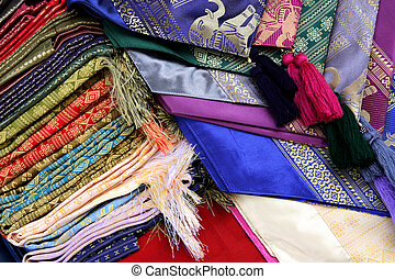 Colorful cloth with oriental patterns at Floating Market in Thailand