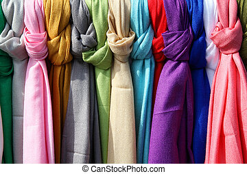 Colorful textiles - Colorful scarves at a market in Italy. ...