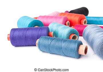 Colorful thread bobbins, isolated