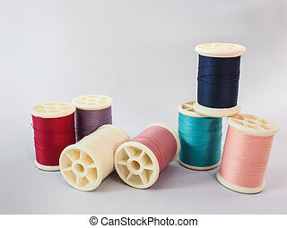 Colorful thread on a white background.