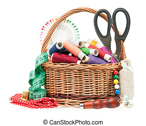 Colorful threads in a wicker basket with sewing accessories...