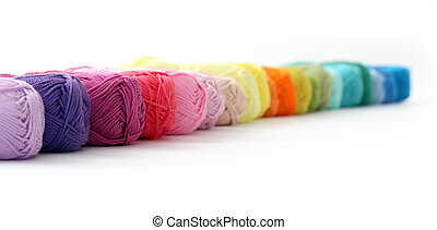 Colorful threads on the table - Colorful threads on a white...