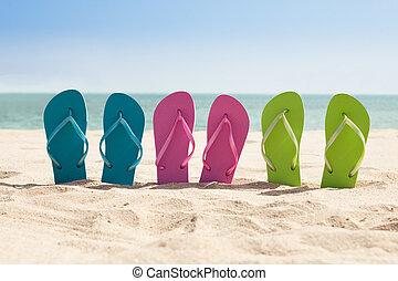 Pairs Of Flip-flops On Beach - Colorful Three Pairs Of Flip-...