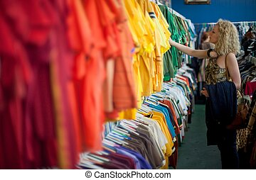girl shopping in a clothing thrift store