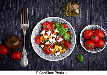 Colorful tomatoes salad with feta cheese