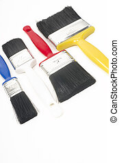 Colorful Tools for Creating Paint Brushes Lay Together on White