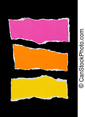 colorful torn paper on black paper background