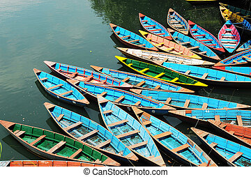 Colorful tour boats parking at the lakeside