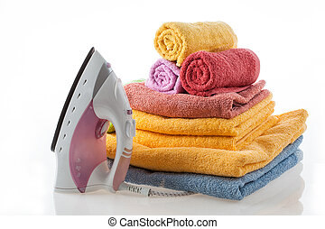 Colorful towels and iron
