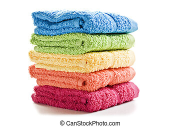 Colorful towels on a white background with space for text