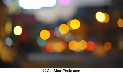 Colorful traffic lights bokeh circles on night city street. Abstract background