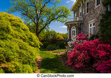 Colorful trees and bushes behind the mansion at Cylburn Arboretum, Baltimore, Maryland.