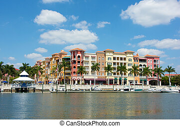 colorful tropical buildings overlooking water - Colorful...