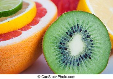 Colorful tropical fruits - lemon, kiwi, lime, grapefruit