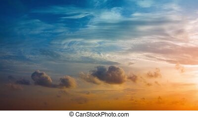 Colorful Tropical Sunset with Puffy Clouds