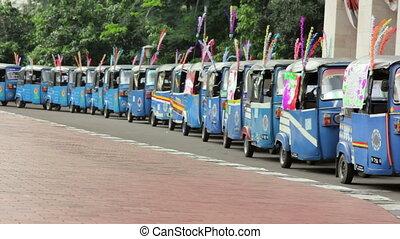 colorful tuktuk in indonesia