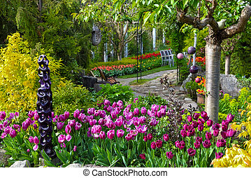 Colorful tulips and a stone path in a spring garden