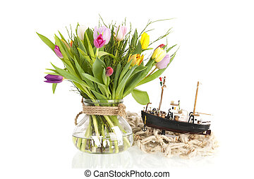 Colorful tulips in glass vase