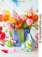 Colorful tulips in little vintage bucket