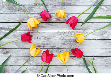 Colorful tulips on wooden planks. Space for text.