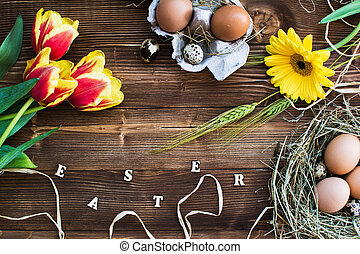 Colorful tulips with eggs on wooden. Happy easter. Spring time.