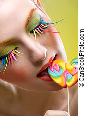 Colorful twisted lollipop and colorful extreme fashion makeup